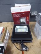 2 boxed and one unboxed 100w LED slimline floodlights with PIR