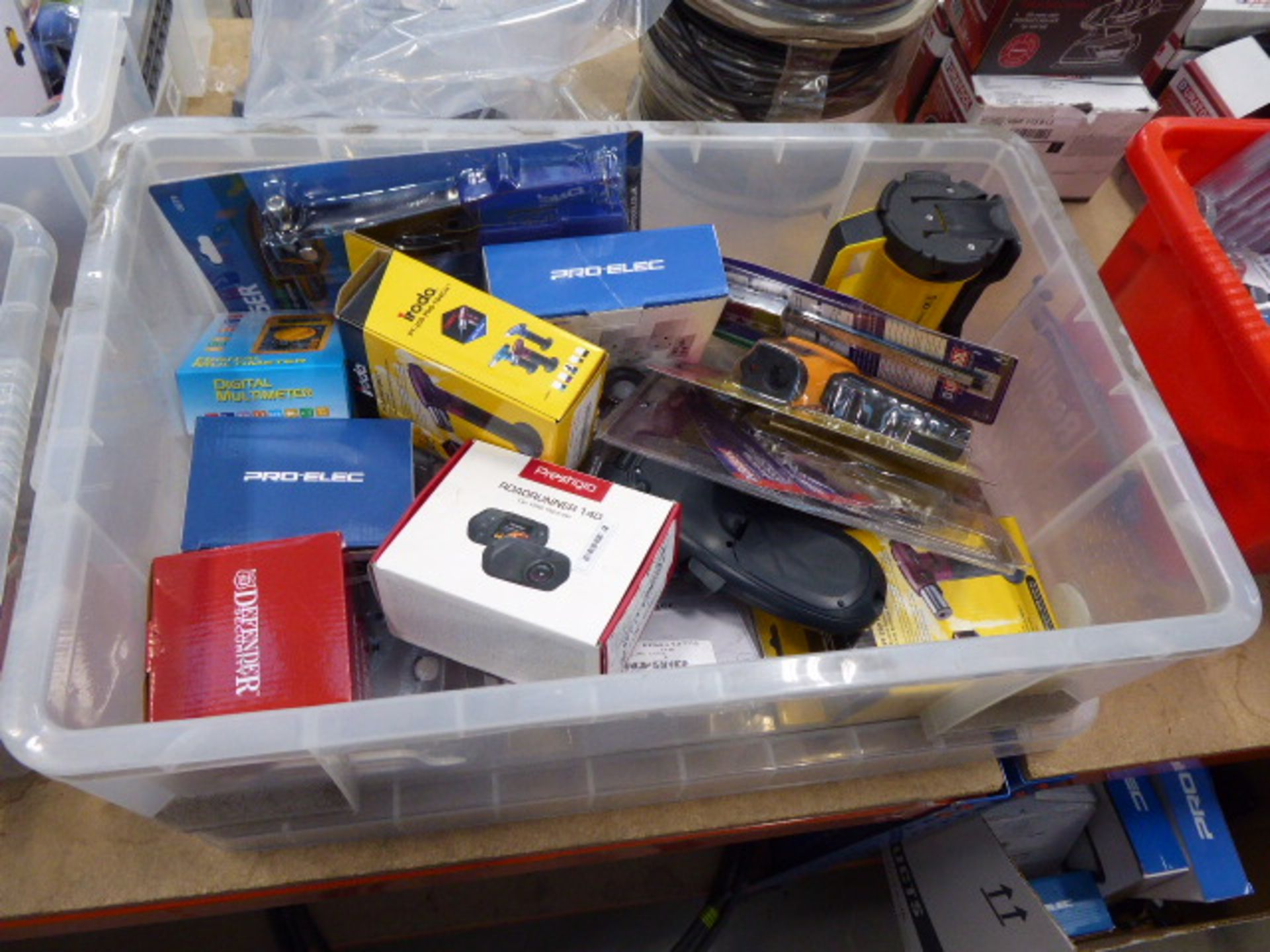 Large box containing locking pliers, wireless sockets, multimeters, security cameras, extension