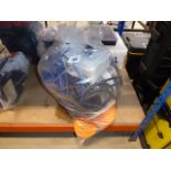 Bag containing orange cable, black cable rubber and a junction box