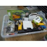 Box containing chainsaw blades, lights, wireless doorbell, extension cable, multimeter, etc