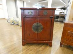 A late 20th century Oriental cabinet, two drawers over a pair of doors, painted red, w. 72 cm