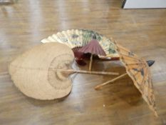 A large late 20th century Oriental fan, l. 76 cm, two parasols and a canework fan (4)