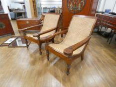 A pair of Anglo-Indian caned plantation chairs with pivoting leg rests, max w. 73 cm