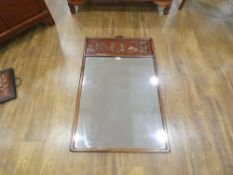 A late 20th century Oriental wall mirror, partially painted red and decorated with traditional