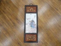 A late 20th century Oriental panel partially painted red and decorated with traditional figures,