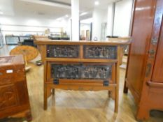 A late 20th century Oriental altar style table made for use as a TV cabinet, decorated with