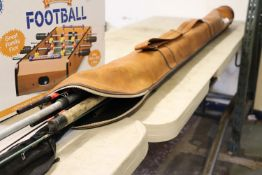 (1085) Leather fishing bag and contents of various fishing rods