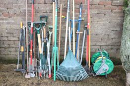 Collection of garden tools incl. hose, various forks, rakes, etc.