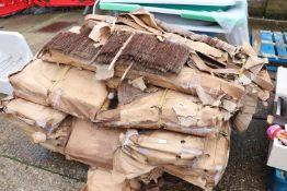 Pallet of various raffia lawn edging