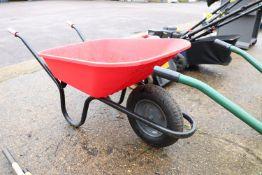 Black framed red plastic wheelbarrow