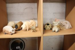 Collection of 9 ceramic pigs