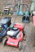 Petrol engine rotary lawn mower with small petrol can and some 4 stroke lawn mower oil