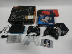 Bag containing gaming acccessories; controllers, Switch cases, N64 game Star Wars Shadows of the