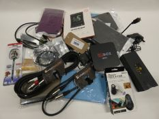 Bag containing audio cables, tablet cases, Cross pen, tracking fob, android box etc