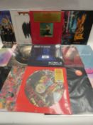 Box containing LP and 45 records to include Kayne West, Chase & Status, The Beatles, Fleetwood