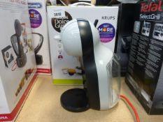 A boxed Nescafe Dolce Gusto Mini Me coffee machine