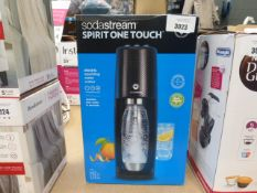 A boxed Soda Stream electric sparkling water maker