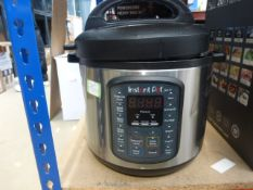 An unboxed Instant Pot (dented)