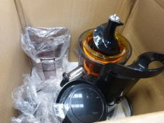 A boxed Fridja juicer with attachments