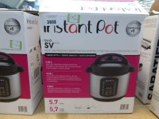 A boxed Instant Pot Multi Use pressure cooker