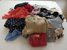 Large stillage containing assorted ladies and men's clothing