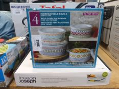 Box of microwavable bowls and a Joseph Joseph kitchen tool set