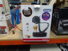 A boxed Nescafe Dolce Gusto Infinissima coffee machine