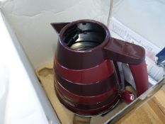 Boxed DeLonghi red electric kettle