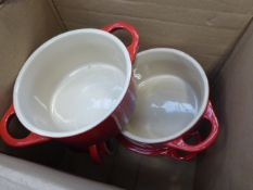 Box containing some Le Creuset small serving bowls