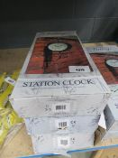 3 boxed station clocks