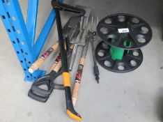 Small quantity of assorted garden tools, hose reel and a Fiskers weeder