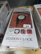 2 boxed station clocks