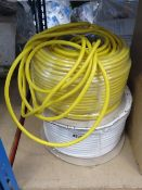 Roll of white cable and yellow cable