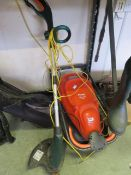 Electric Flymo lawnmower with an electric strimmer