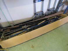 Box containing large quantity of various branded fishing rod parts