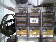 3 boxed and 1 unboxed pair of Rig 400 gaming headsets by Plantronics