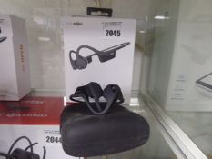 Aftershocks Air bone conduction headset in box and 1 loose set with carry case