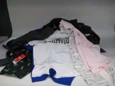 Bag containing children's clothing to inc. boys swimming shorts, grey jogging pants, Champion t