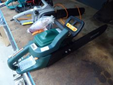 Green petrol powered chainsaw