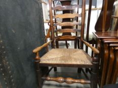 Oak ladder back arm chair with strung seat