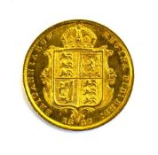 A Victorian shield back half sovereign dated 1887