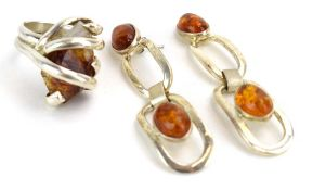 A late 20th century silver dress ring set amber coloured quartz within an entwined setting,