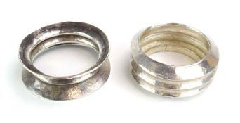 A late 20th century hammered silver bangle of ribbed form, maker BI, London 1990, internal d. 6.