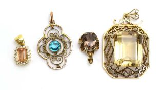 A small yellow metal cluster pendant set rectangular cut peach coloured stone within a border of