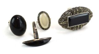 Four silver and metalware dress rings set black onyx and other stones (4)