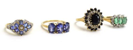 A 9ct yellow gold dress ring set pale blue stones and small diamonds in a flowerhead setting,