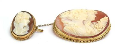 A 9ct yellow gold mounted cameo brooch of oval form depicting two females and a dove, w. 4.