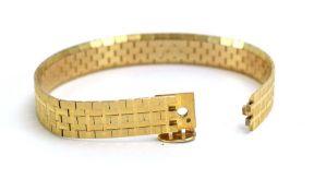 A 9ct yellow gold articulated brick link bracelet, maker NK, London 1969, l. 18 cm, 25.