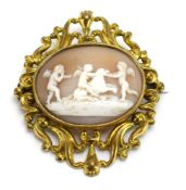 A 19th century yellow metal cameo brooch of oval form depicting putti at play within an openwork
