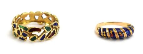 A late 20th century yellow metal ring of openwork design decorated in coloured enamels,